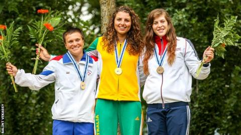 Kimberley Woods (right) wins bronze in the C1W World Cup in Spain