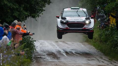 Elfyn Evans' car takes off over a jump during the Orlen Rally in Poland