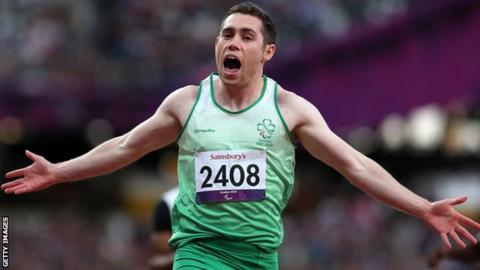 Jason Smyth celebrates after his T13 100m win at the London Paralympics