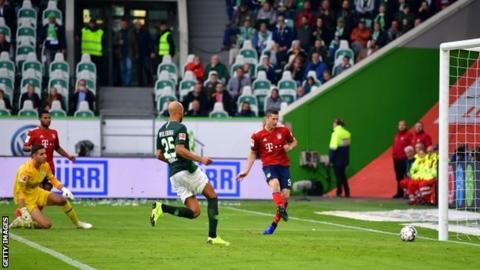 Robert Lewandowski scores for Bayern Munich at Wolfsburg