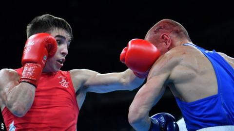 Conlan (left) lost controversially to Nikitin in Tuesday's quarter-finals