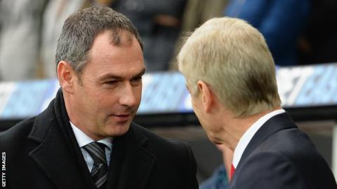 Paul Clement greets Arsene Wenger at Swansea