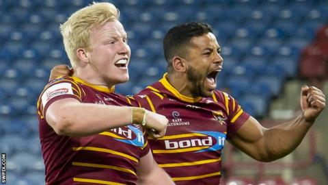 Huddersfield players Matty English and Kruise Leeming celebrate a try against Wakefield