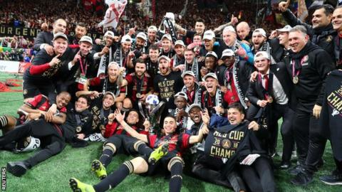 Atlanta United players celebrate after winning the MLS Cup