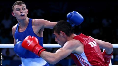 Sean McComb will hope to clinch at least a silver medal by winning his semi-final in Baku on Friday