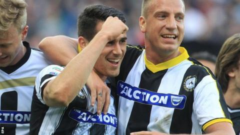 Udinese players wearing different shirts