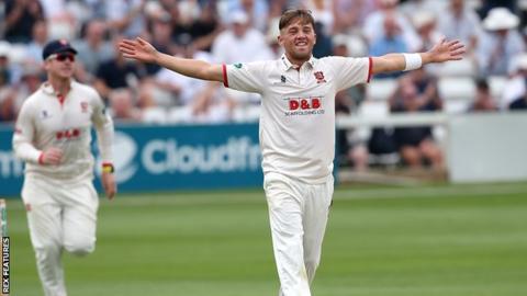 Aaron Beard celebrates a wicket