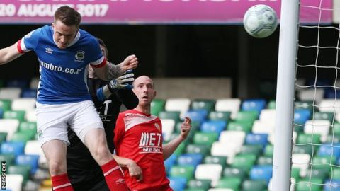 Aaron Burns scores for Linfield in the 4-1 victory over Portadown at Windsor Park in September