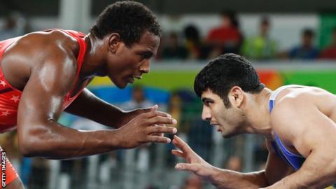 J'den Cox and Alireza Karimi prepare to wrestle at Rio 2016