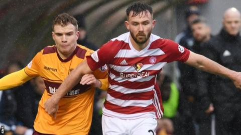 Motherwell's Chris Cadden (left) and Hamilton's Scott McMann chase down the ball