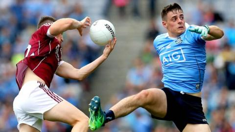 Johnny Heaney of Galway and Dublin's Brian Howard
