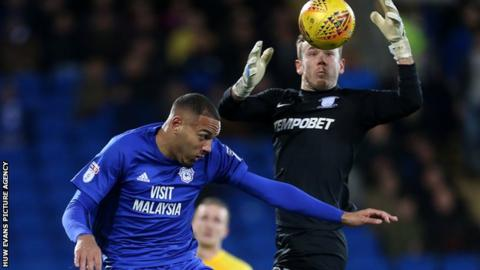Kenneth Zohore and Chris Maxwell challenge for the ball