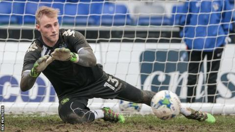 Rob Lainton's penalty save just before half-time proved crucial for Wrexham