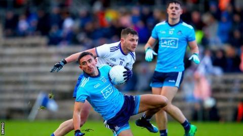 Monaghan's Dermot Malone challenges Dublin goalscorer Niall Scully