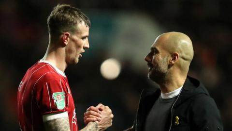 Aden Flint and Pep Guardiola