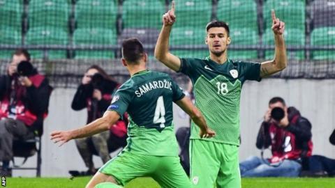 Slovenia's Rok Kronaveter (right) and Miral Samardzic celebrate their winner