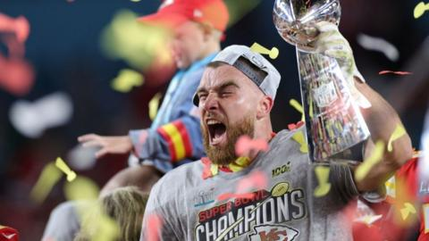Travis Kelce of the Kansas City Chiefs celbrating winning the LIV Super Bowl