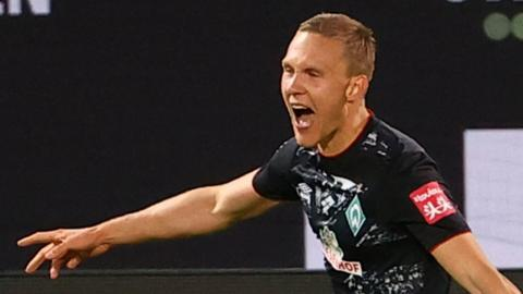 Werder Bremen's Ludwig Augustinsson celebrates scoring his side's second goal against Heidenheim