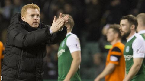 Hibs manager Neil Lennon applauds supporters after their 3-0 win over Dundee united