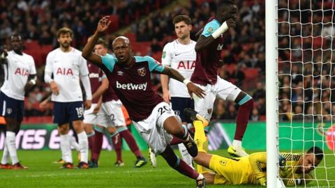 Andre Ayew wheels away after leading West Ham's fight-back against Tottenham on Wednesday