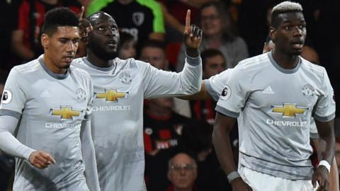 Romelu Lukaku celebrates scoring for Manchester United against Bournemouth with team-mates Chris Smalling and Paul Pogba
