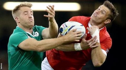 Ireland's inside centre Luke Fitzgerald in action against Matt Evans of Canada