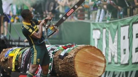 Fanendo Adi with a chainsaw