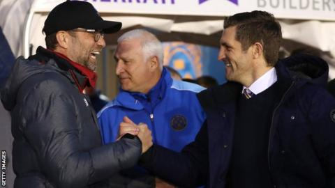 positive people Liverpool manager Jurgen Klopp and Sam Ricketts shake hands