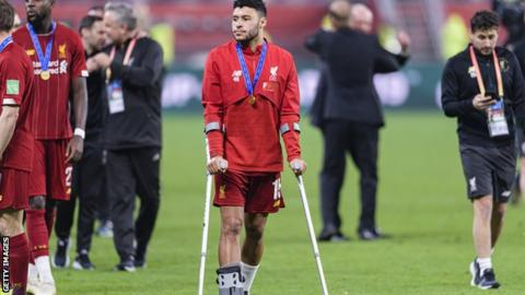 Alex Oxlade-Chamberlain on crutches after the Club World Cup final