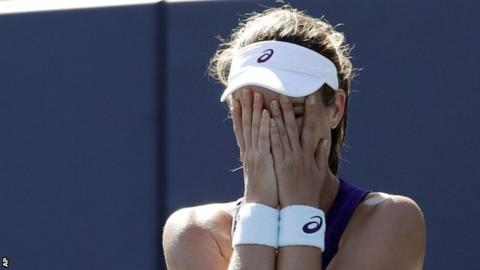 Johanna Konta covers her face with her hands after winning her first WTA title