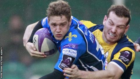 Dragons fly-half Angus O'Brien in action against Worcester