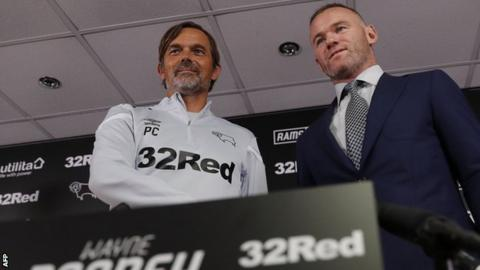 Phillip Cocu and Wayne Rooney