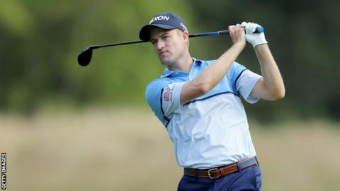 Russell Knox plays a shot at The Barclays tournament