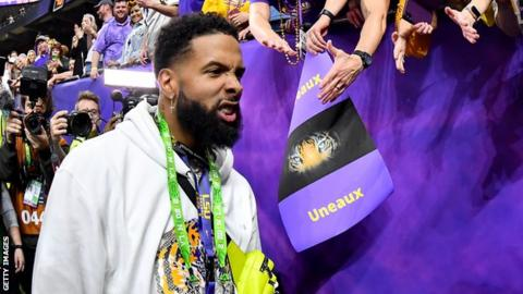 Cleveland Browns wide receiver Odell Beckham Jr walks past LSU fans at the College Football Championship game