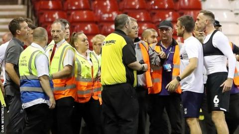An altercation at the end of Forest v Derby in the EFL Cup