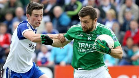 Fermanagh's Ryan McCluskey battles with Monaghan's Shane Carey in the first half at Breffni Park