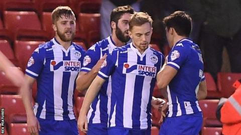 Wigan celebrate Andy Kellett's opening goal at Barnsley