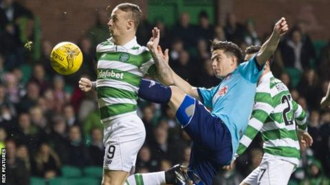 Danny Redmond of Hamilton challenges Leigh Griffiths of Celtic