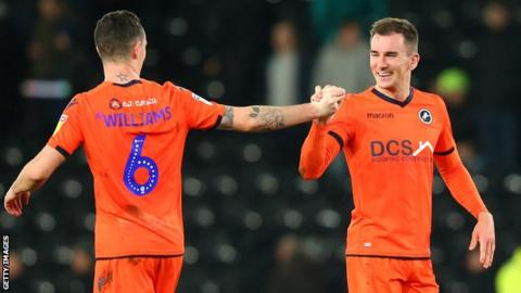 Shaun Williams and Jed Wallace celebrate the latter's goal against Derby County