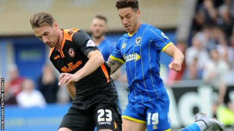 Newport's Alex Rodman is challenged by David Fitzpatrick