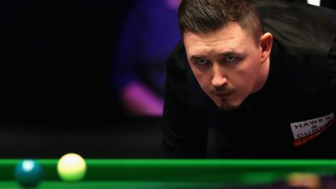 Kyren Wilson looks down the table