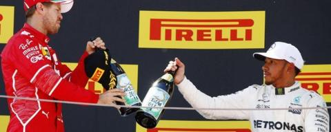 Vettel and Hamilton celebrate on the podium
