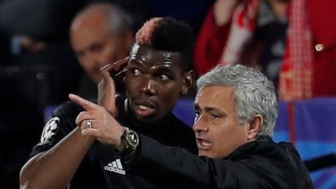 Manchester United midfielder Paul Pogba (left) and manager Jose Mourinho