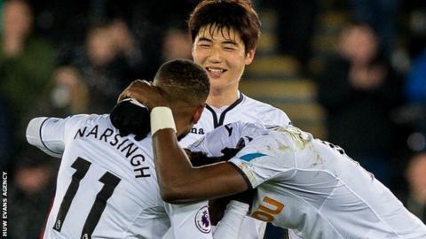 Swansea celebrate Wilfried Bony's winning goal against West Brom