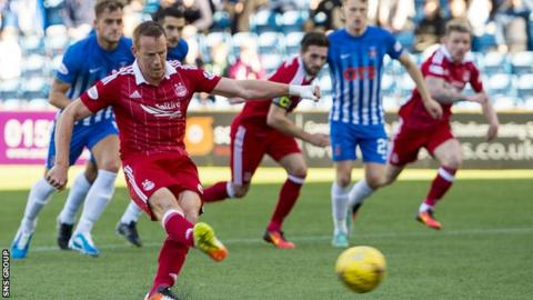 Adam Rooney sweeps the ball home from a controversial penalty award