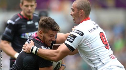 Ospreys' Rhys Webb grapples with Ulster scrum-half Ruan Pienaar