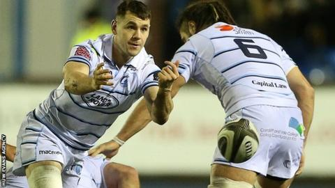 Tomos Williams passes the ball from the base of a ruck for Cardiff Blues
