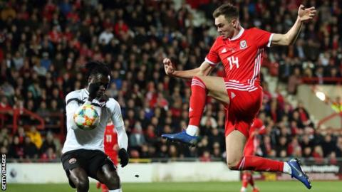 Ryan Hedges (right) in action for Wales