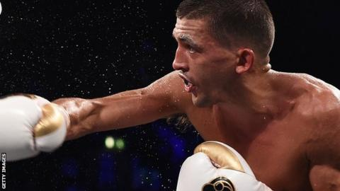 Spray flies as Lee Selby throws a punch during a title defence
