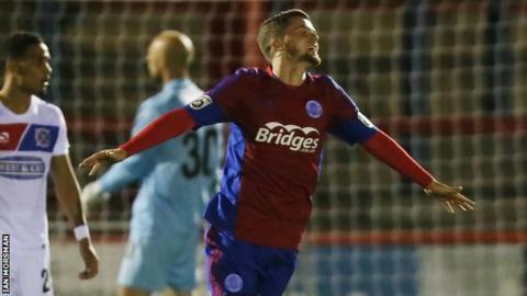 Adam McDonnell celebrates scoring a goal for Aldershot Town